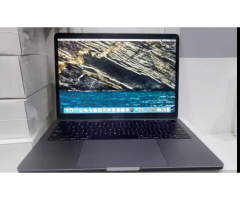 Apple Macbook pro ( Touch Bar 13 inch, 2017, Four thunderbolt 3 ports